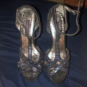 Black sparkly high heels.